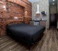Кровать в номере комфорт с сауной